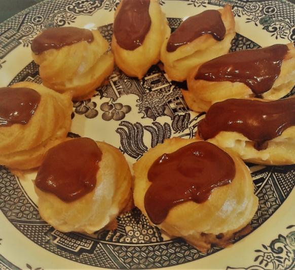 Palos de crema con cobertura de chocolate